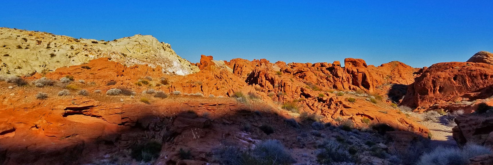 Contrasting Red and White Rock Formations in the Northern Portion of Prospect Trail in Valley of Fire State Park, Nevada