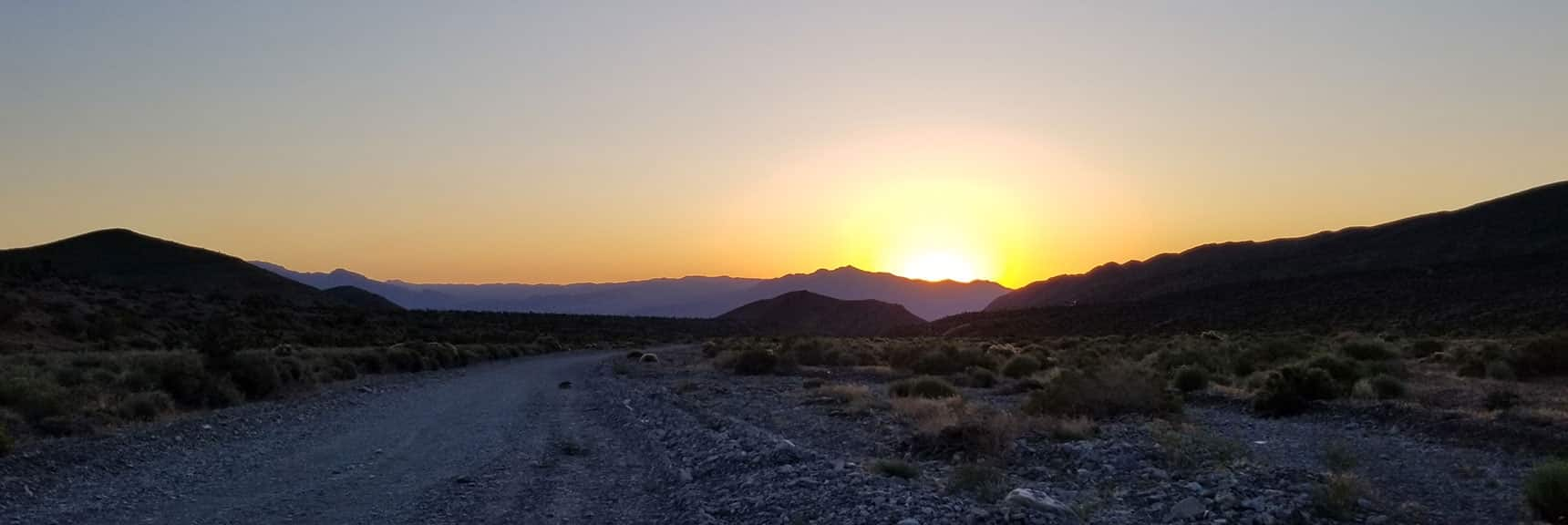 Looking Back Down Harris Springs Road to the Rising Sun Over Gass Peak | La Madre Mountain Northern Approach, Nevada