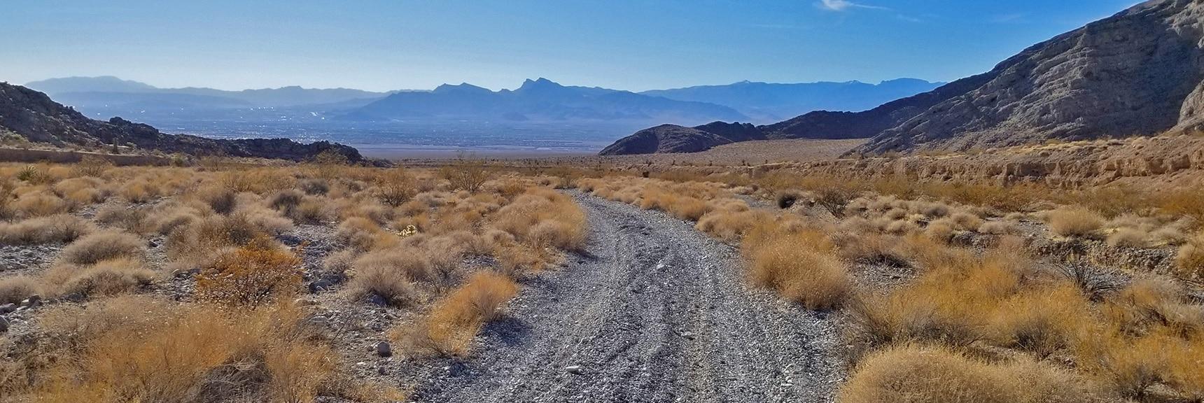 View Down Pass Into North Las Vegas. 3-6-Inch Deep Gravel Slows Mountain Bike to a Walk | Gass Peak Road Circuit | Desert National Wildlife Refuge | Nevada