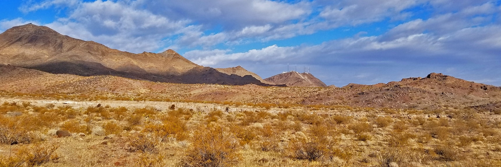 View Back Toward the Trailhead Marked by Communication Towers   McCullough Hills Trail in Sloan Canyon National Conservation Area, Nevada