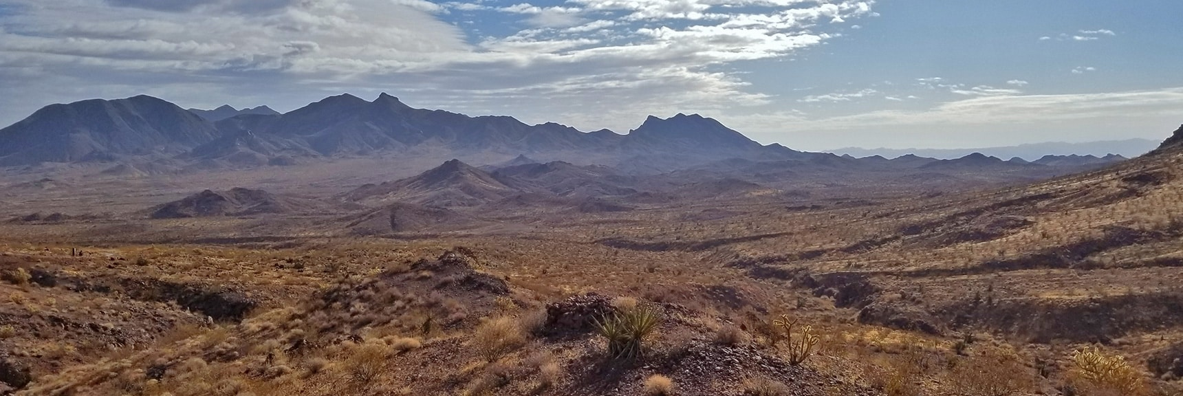 Looking East. Lake Mead is Beyond the Ridge System in View   McCullough Hills Trail in Sloan Canyon National Conservation Area, Nevada