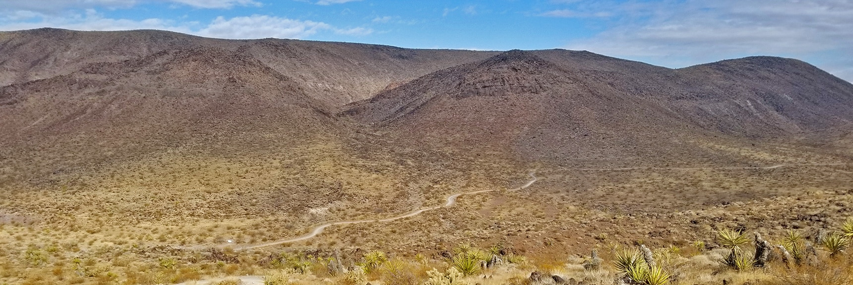 Looking Back Down the Trail Toward the Trailhead. Have Gained a Lot of Elevation!   McCullough Hills Trail in Sloan Canyon National Conservation Area, Nevada