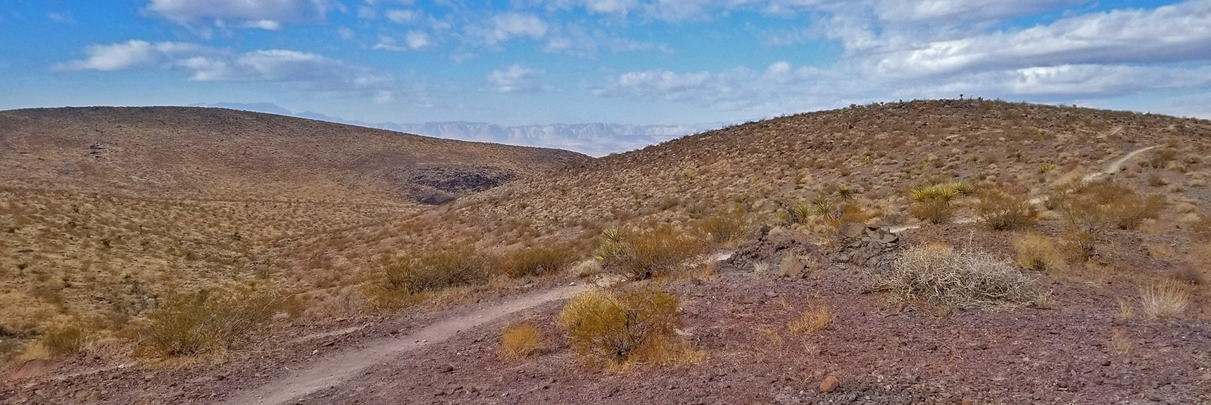 Looking Toward Anthem and Across the Las Vegas Valley to Rainbow Mountains and Red Rock Park  McCullough Hills Trail in Sloan Canyon National Conservation Area, Nevada