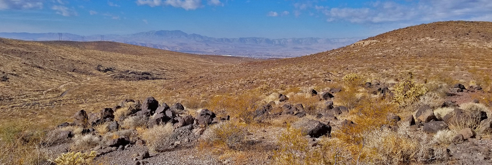 View Across Las Vegas Valley Toward Potosi Mt, Rainbow Mountains and Red Rock Park   McCullough Hills Trail in Sloan Canyon National Conservation Area, Nevada