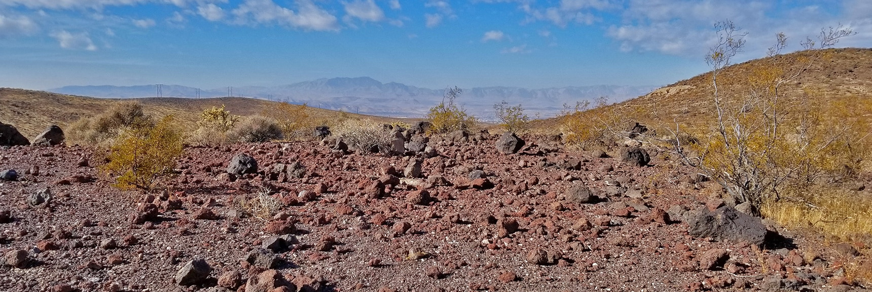 Lots of Volcanic Rock in the Hills. Las Vegas Valley and Rainbow Mountains Backdrop   McCullough Hills Trail in Sloan Canyon National Conservation Area, Nevada