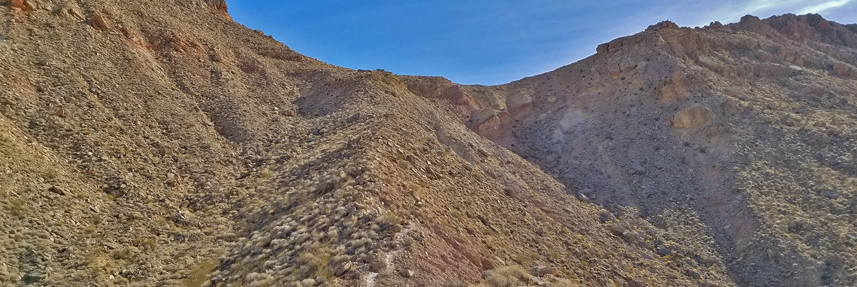 Ascending a Ridge Toward a Spectacular Bowl of Fire Overlook   Anniversary Narrows   Muddy Mountains Wilderness, Nevada