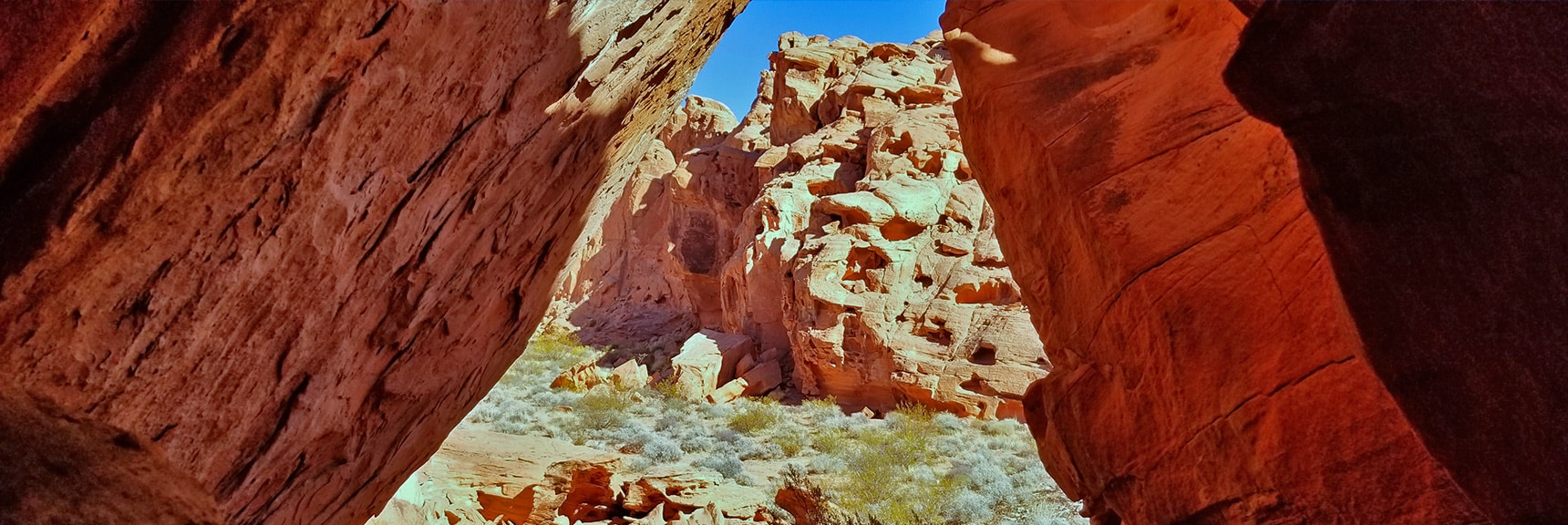 Viewing the Bowl Through Intricate Rock Passages | Bowl of Fire, Lake Mead National Recreation Area, Nevada