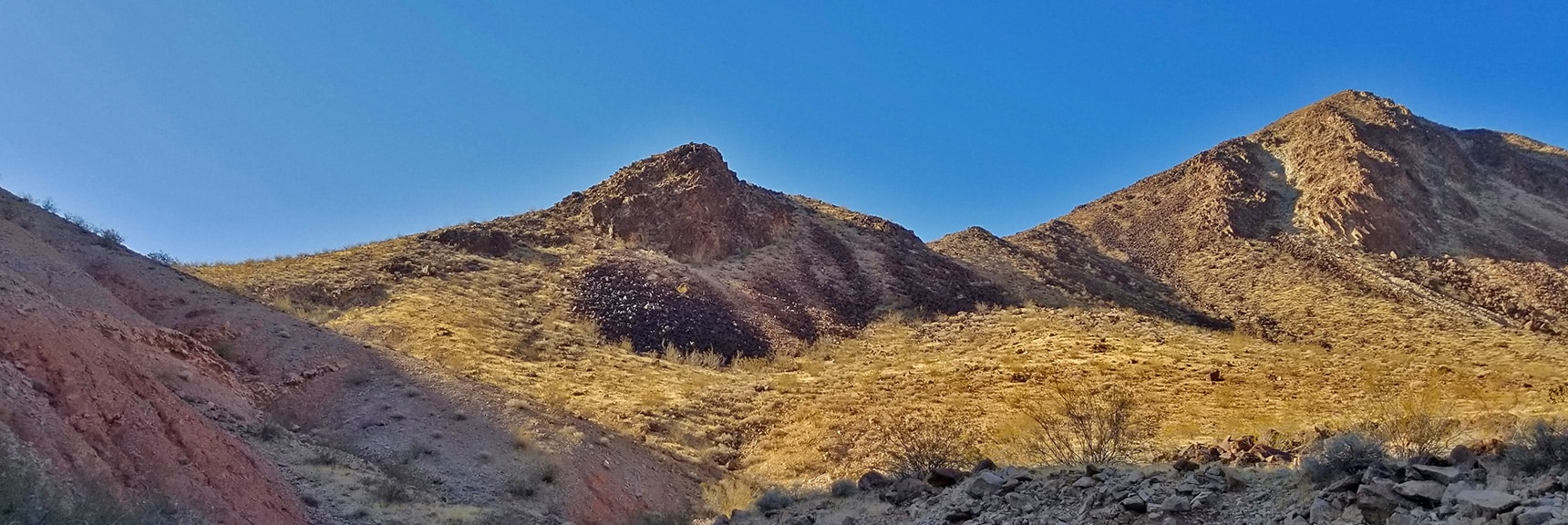 View Back to Lava Butte and the Saddle Pass to the Northern Summit Approach Route. | Lava Butte | Lake Mead National Recreation Area, Nevada