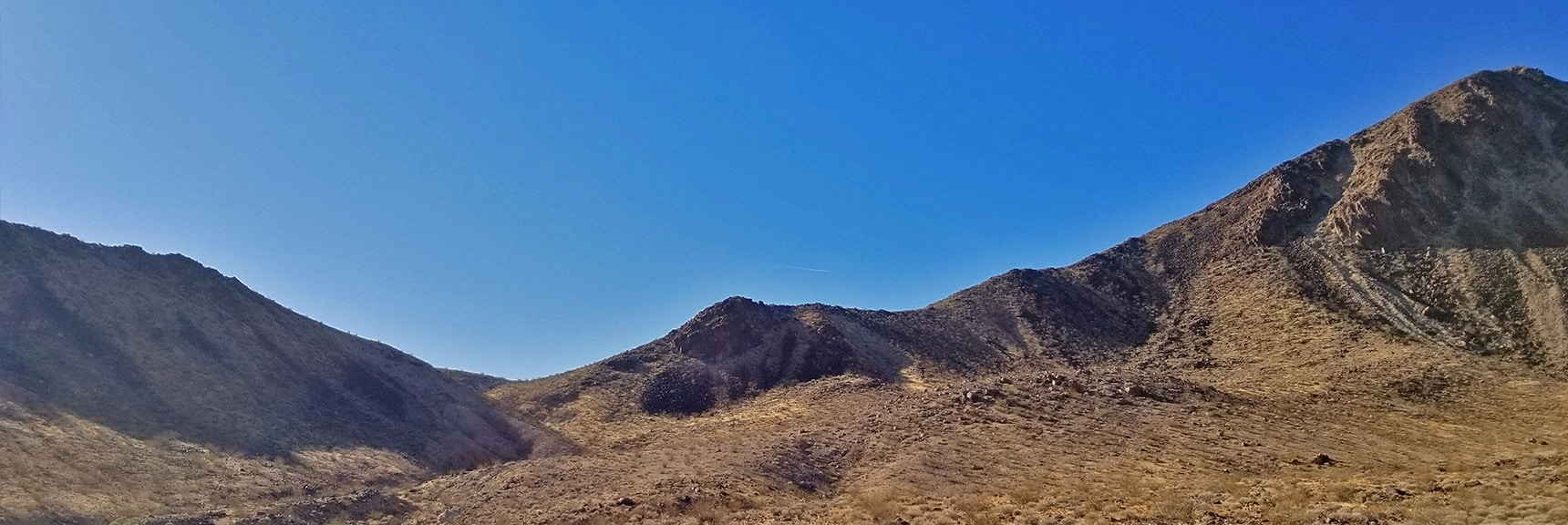 View Bact to Lava Butte and the Saddle Pass to the Northern Summit Approach Route. | Lava Butte | Lake Mead National Recreation Area, Nevada