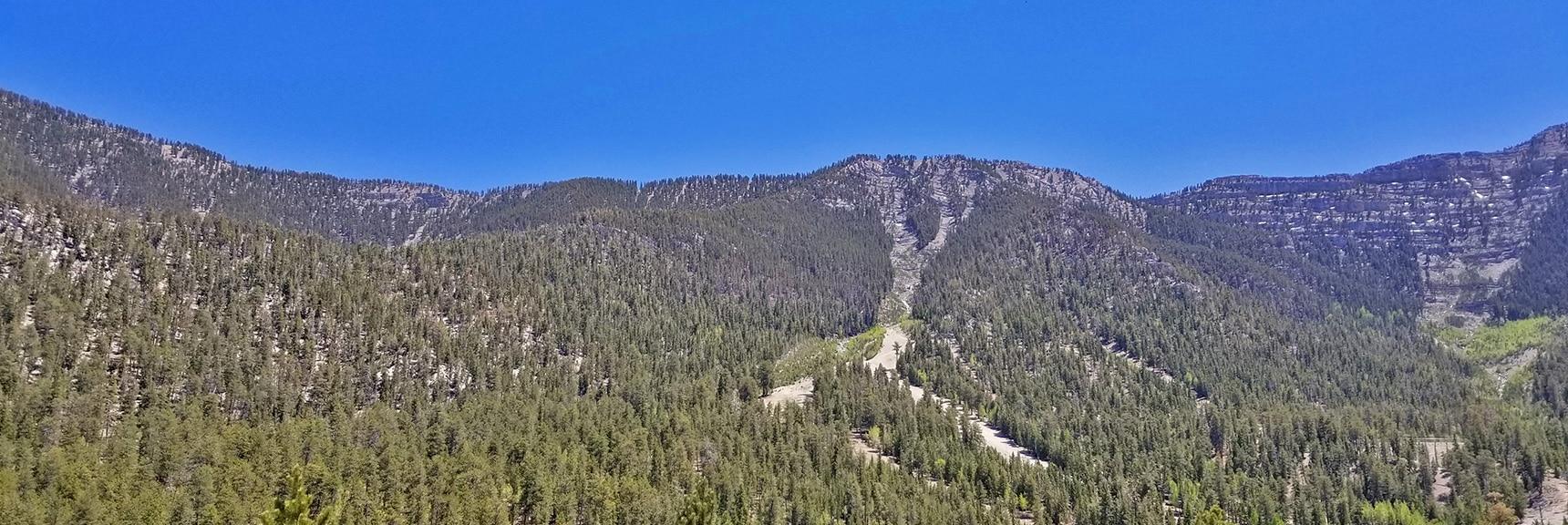 View Down to Lee Canyon Ski Runs and North Rim of Kyle Canyon from Bonanza Trail | Base of McFarland Peak via Bristlecone Pine Trail and Bonanza Trail | Lee Canyon | Spring Mountains, Nevada