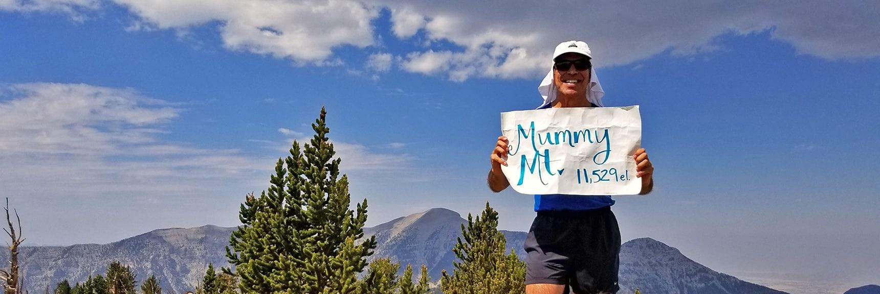 Standing on Mummy Mountain's Summit. Charleston and Lee Peaks in Background. | Mummy Mountain NE Cliffs Descent | Mt Charleston Wilderness | Spring Mountains, Nevada