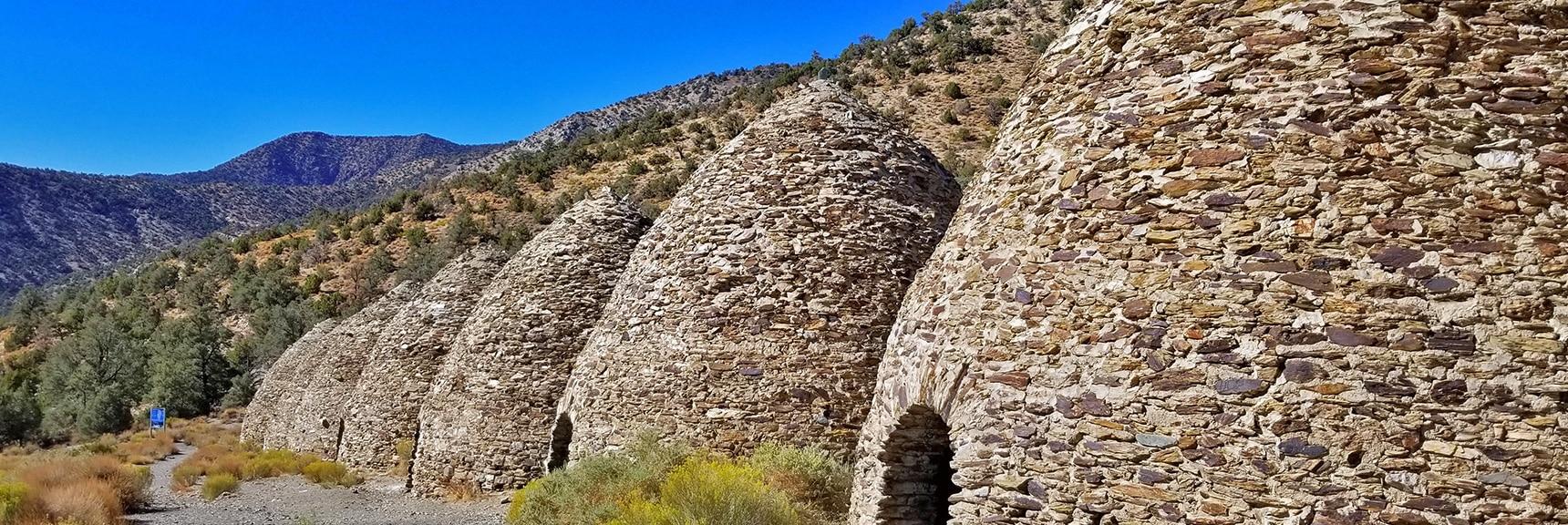 Charcoal Kilns with Wildrose Peak Trailhead to the Left and Wildrose Peak Area Above | Charcoal Kilns | Death Valley, California