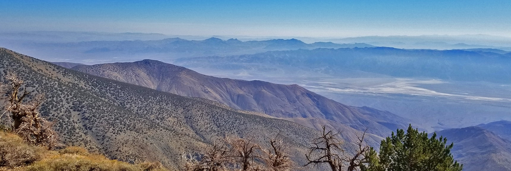 A Look Down to Bad Water, Devil's Golf Course and Funeral Mountains in Death Valley   Telescope Peak Summit from Wildrose Charcoal Kilns Parking Area, Panamint Mountains, Death Valley National Park, California